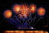 Fototapety holiday fireworks of golden color on a black sky background