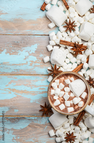 Foto op Canvas Chocolade Hot Chocolate, White Marshmallows and Winter Spices on Blue Wooden Background Copy Space Flat Lay Top View Vertical