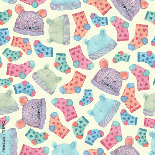 Fototapeta Seamless pattern with colorful hats and socks. Children clothes illustrated in watercolor.