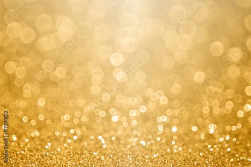 Złote tło uroczystości na rocznicę, Sylwestra, Boże Narodzenie, spadające monety, ślub lub urodziny