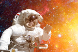 Astronaut in outer space against the backdrop of the outer space. Elements of this image furnished by NASA. - 177840674
