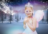 Girl with fairy princess costume and frozen winter forest