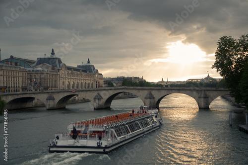 Boat passing under bridge on the river Seine. Paris .France Poster