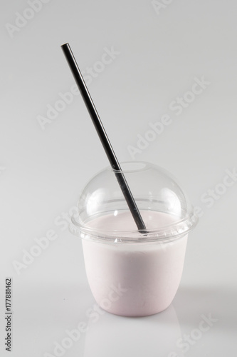 Foto op Aluminium Milkshake Glass of milkshake in plastic transparent cup isolated on white background