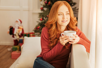 Beautiful woman enjoying christmas morning