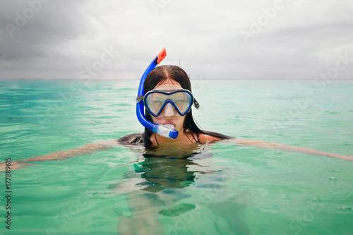 Fotobehang Zanzibar Portrait of young woman wearing mask for snorkeling in ocean