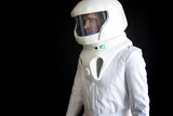 Astronaut in a helmet looks down. Fantastic space suit. Exploration of outer space. - 177893269