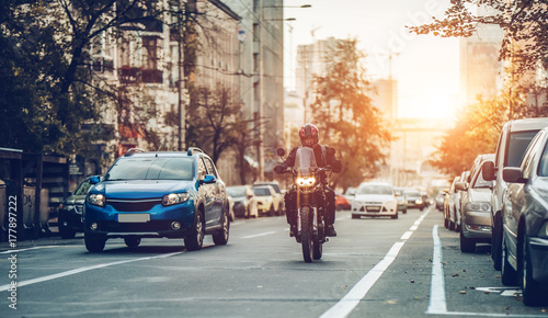 Motorcycle and cars on street - 177897222