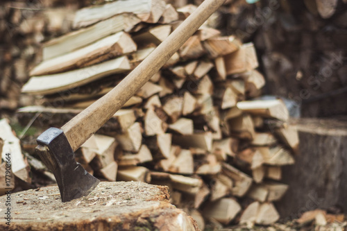 Poster Brandhout textuur Axe and woodpile. Horizontal image.