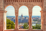 Hungary. Budapest. Parliament view through Fishermans Bastion. - 177910819
