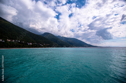 Fotobehang Groen blauw beautiful sea shore on the background of mountains