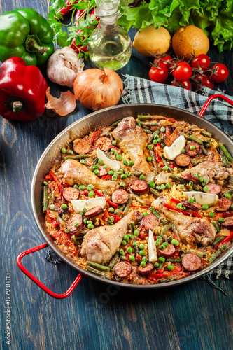 Traditional paella with chicken legs, sausage chorizo and vegeta - 177938013