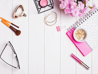 Stylish feminine accessories on the white wooden background