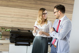 Business people talking in office by the scanner mashine - 177955819
