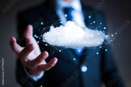 Fototapeta Cloud computing concept - connect to cloud. Businessman or information technologist.