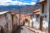 Fototapety Street with steps overlooking Cusco rooftops.