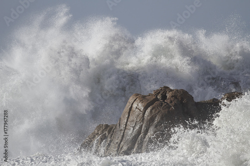 Sea waves breaking over rocks