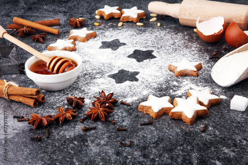 Baking christmas cookies. Typical cinnamon stars bakery Poster