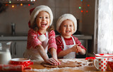 happy children bake christmas cookies - 177978241