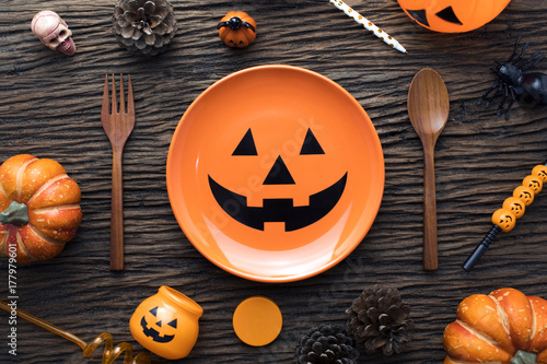 orange dish and decorations of halloween dinner party on wooden table ground Poster