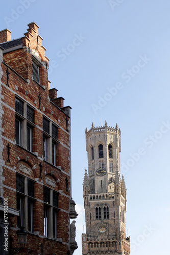 Fotobehang Brugge The medieval architecture of Bruges, details of the building and the tower