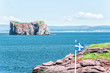 Bonaventure Island Park in Gaspe Peninsula, Quebec, Gaspesie region with picnic tables and view of Perce rock in summer by blue flag