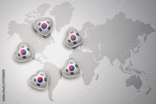 Fotobehang Seoel five hearts with national flag of south korea on a world map background