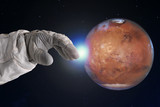 The development of Mars, concept. Hand of astronaut reaches out to Mars. Elements of this image furnished by NASA. - 177995670