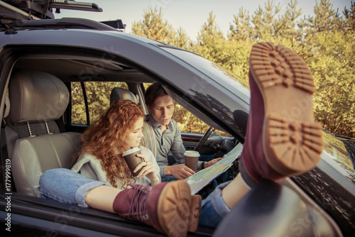 Travel. Couple in car, having a road trip