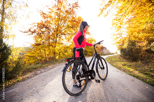 Young active sport girl with bicycle outdoor