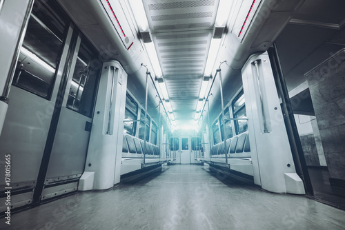 Wide-angle view from bottom of empty modern underground train car interior with Plakát