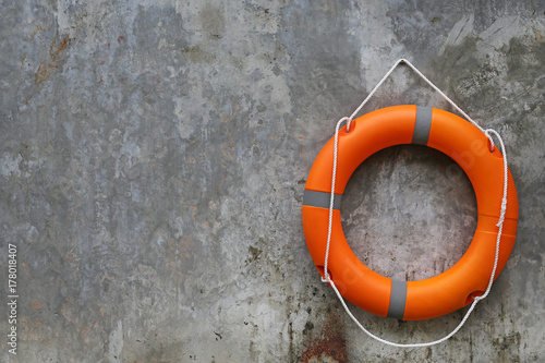 Orange Lifebuoy Hanging On Abstract Cement Wall Background Buy