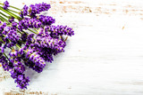 Bouquet of lavender on wooden background with white shabby chic floral design