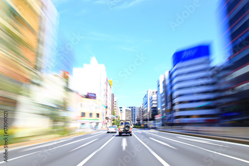 Car driving fast in Tokyo Poster