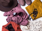 Flat lay with lady's clothes, hat, sun glasses, necklace. Autumn colours accessories on white background - 178044431
