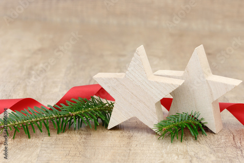 white xmas star, fir branch and red ribbon on wood Poster