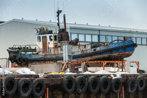 Fotobehang Schip Old tug boat lays on a pier in port of Reykjavik