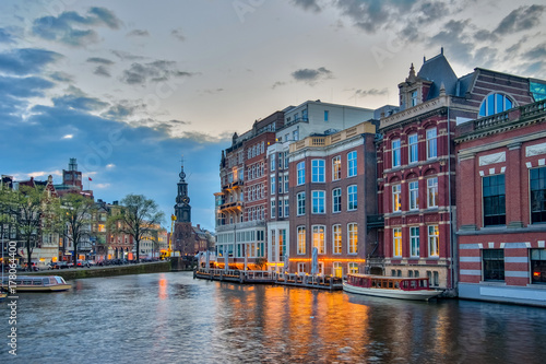 Foto op Plexiglas Amsterdam Amsterdam cityscape with sunset in Netherlands