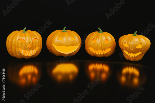 Four scary halloween pumpkins with reflection on the black background