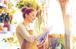 florist woman with clipboard at flower shop - 178091016
