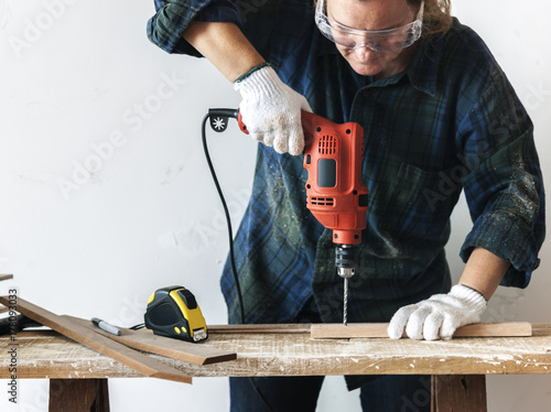 Constractor handyman working and using screwdriver - 178093033