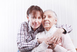 Seniors woman with her caregiver at home - 178112443