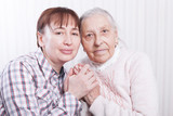 Seniors woman with her caregiver at home - 178112472