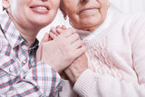Seniors woman with her caregiver at home - 178112488