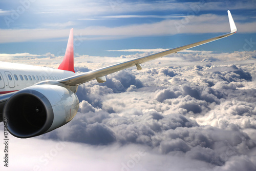 Plane in the sky flight travel transport airplane
