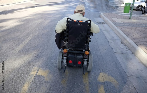 electric wheelchair in the road Poster
