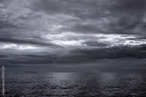 Infrared seascape with a cloudy sky