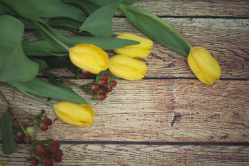 yellow tulips on the table and in the basket