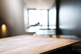 empty wood table in front of blur coffee shop / restaurant background, image can be place product