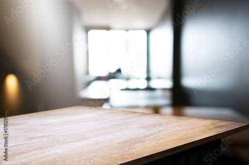 empty wood table in front of blur coffee shop / restaurant background, image can be place product - 178120026